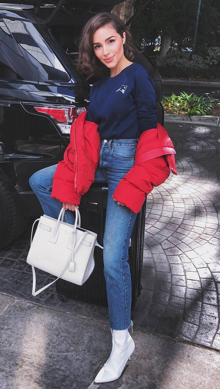 what to wear with a red parka : white bag + jeans + boots + top