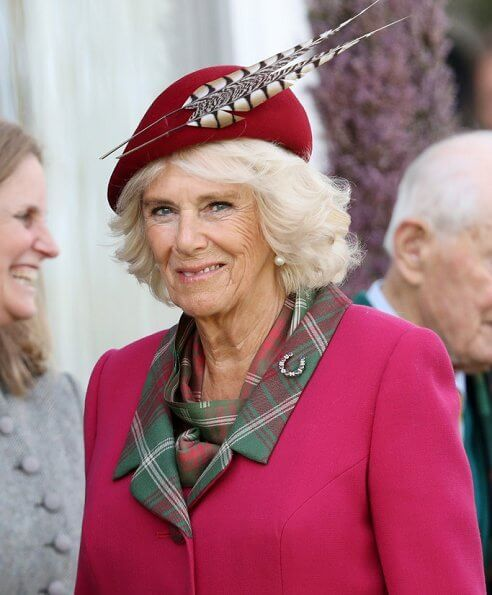 Queen Elizabeth, The Prince of Wales and Duchess of Cornwall, Autumn Phillips and Peter Phillips. Camilla wore a red wool coat by Burberry