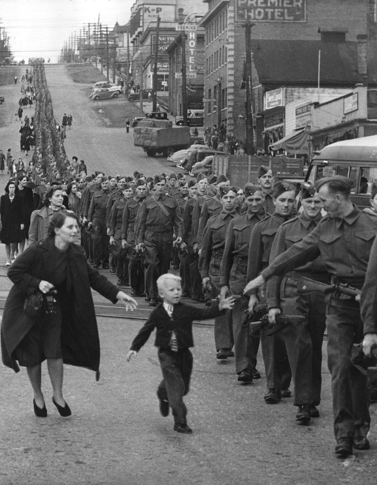 The photo 'Wait for me, Daddy' shows Private Jack Bernard, B.C. Regiment saying goodbye to his son Warren Bernard in New Westminster, 1940.