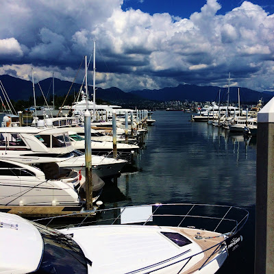 Yachts moored at the docks of Coal Harbour, Vancouver, BC, Canada.