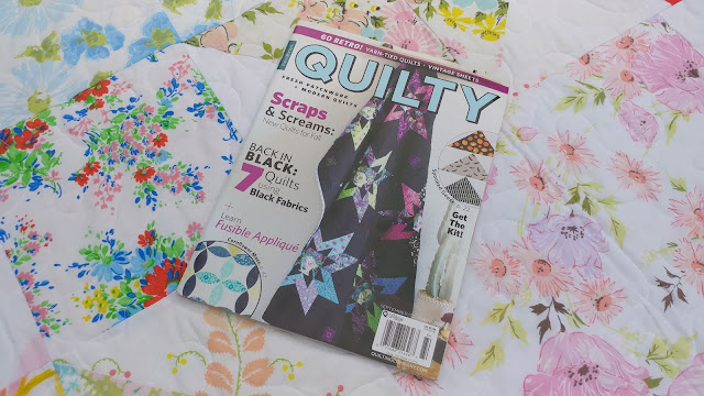 Odd Fellows Chain quilt made from vintage sheets in QUILTY magazine