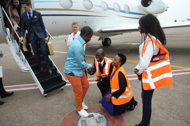 Photos: Airport staff kneel down to welcome wealthy Malawi pastor, Prophet Bushiri as he arrives Uganda in his private jet
