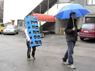 Woman Carrying beer with man holding umbrella