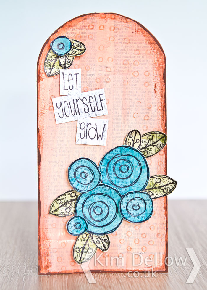 A tag made using the PaperArtsy Eclectica³ {Kim Dellow} EKD01 stamps