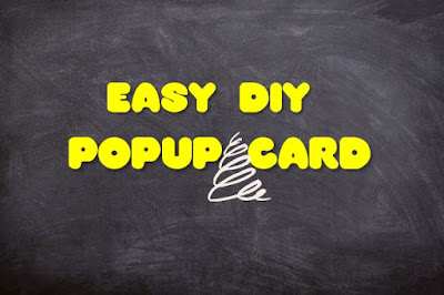 A black background with text in yellow that says 'easy diy popup card'