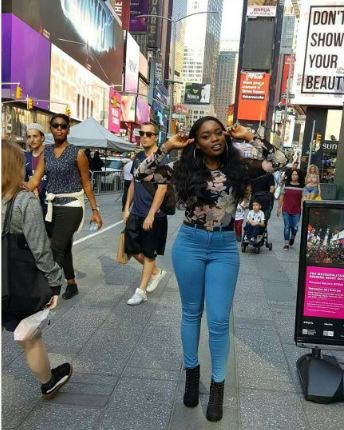 BBNaija's Bisola All Smiles as She Poses with Two Policemen in New York City (Photos)