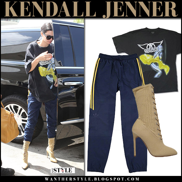 Kendall Jenner in black print t-shirt, blue sweatpants adidas hardies and beige boots yeezy what she wore july 25 2017 airport style