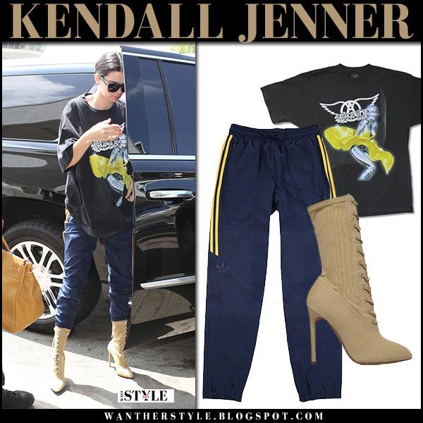 c4fbc0fd9a42 Kendall Jenner in black print t-shirt, blue sweatpants adidas hardies and  beige boots