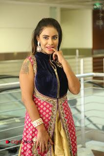 Telugu Actress Sri Reddy Mallidi Stills in White Beautiful Dress at Marriage Needs Bridal Fashion Week 2017 Logo Launch  0042.JPG