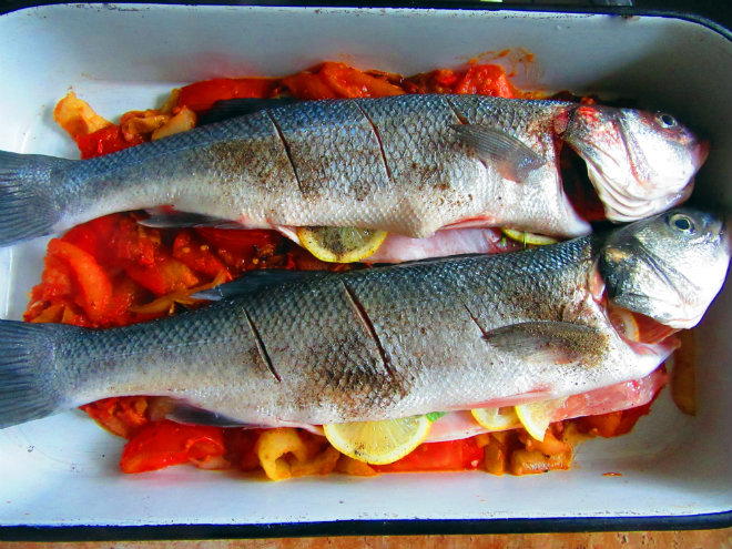 Roasted sea bass with bacon and tomatoes by Laka kuharica: Drizzle over the olive oil and cook in the oven