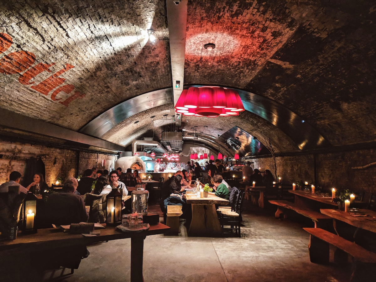 Mother London sits underneath the exposed, brick arches of the railway.
