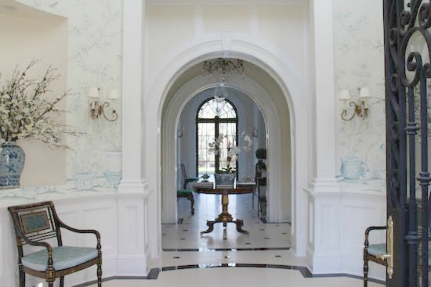 Breathtaking hall with archway and handpainted wallcovering in Enchanted Home house