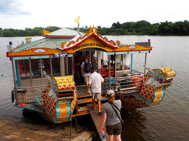 Boarding a dragon boat on the Perfume River, in Hue, Vietnam