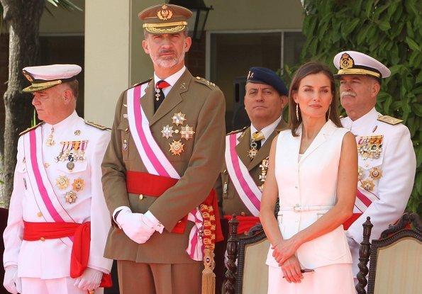 Queen Letizia of Spain wore Felipe Varela dress and Carolina Herrera suede pumps, carried Carolina Herrera bag from Camelot collection