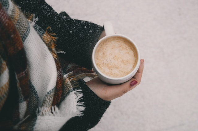 winter warmth with coffee and scarves