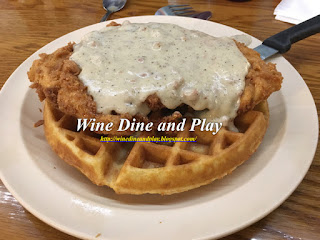 The classic southern brunch dish of chicken and waffles at Skyway Jacks is served with sausage gravy