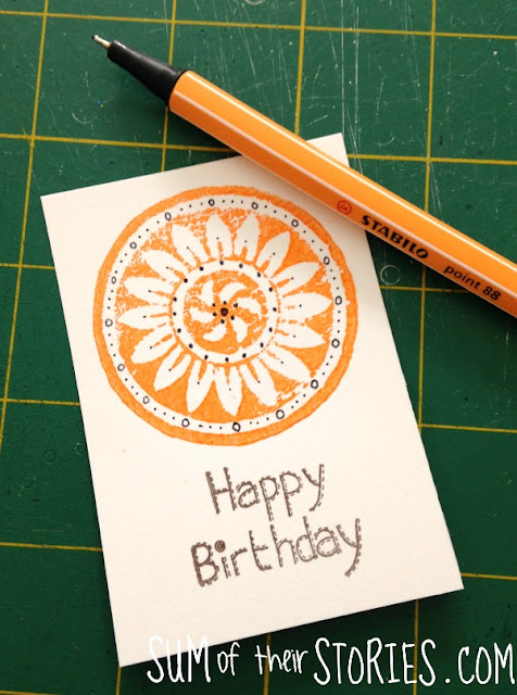printed card with doodle