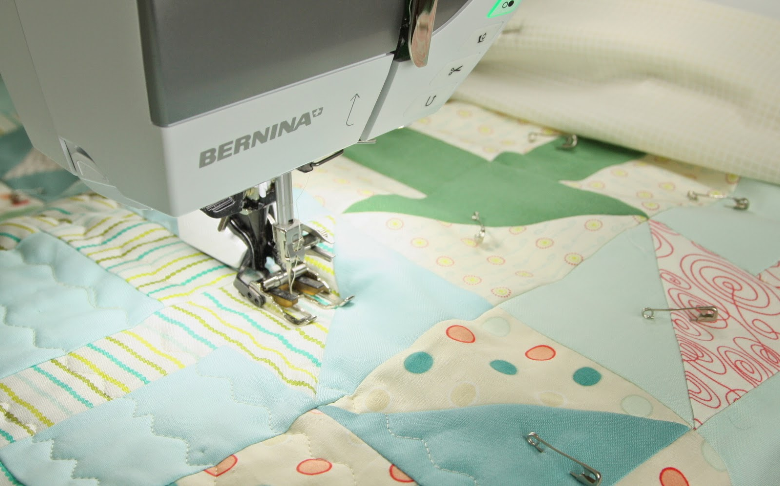 Using a walking foot to machine quilt wavvy lines on a quilt.