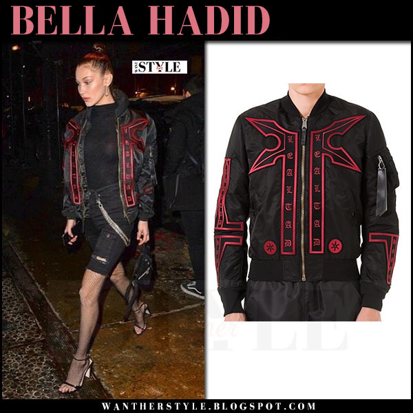 Bella Hadid in black embroidered jacket, black shorts and black fishnet tights wolford new york fashion week 2017