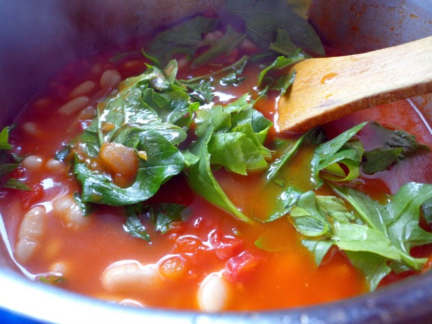 Stir in the beans and spinach