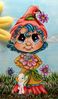 close up of coloured sweet flower gnome on colours and cards