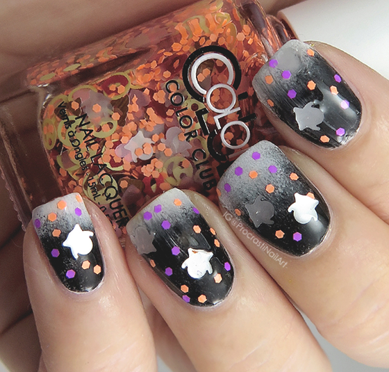 Halloween nail art with emoji ghost glitter