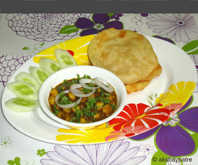 palak chole bhature in a serving plate