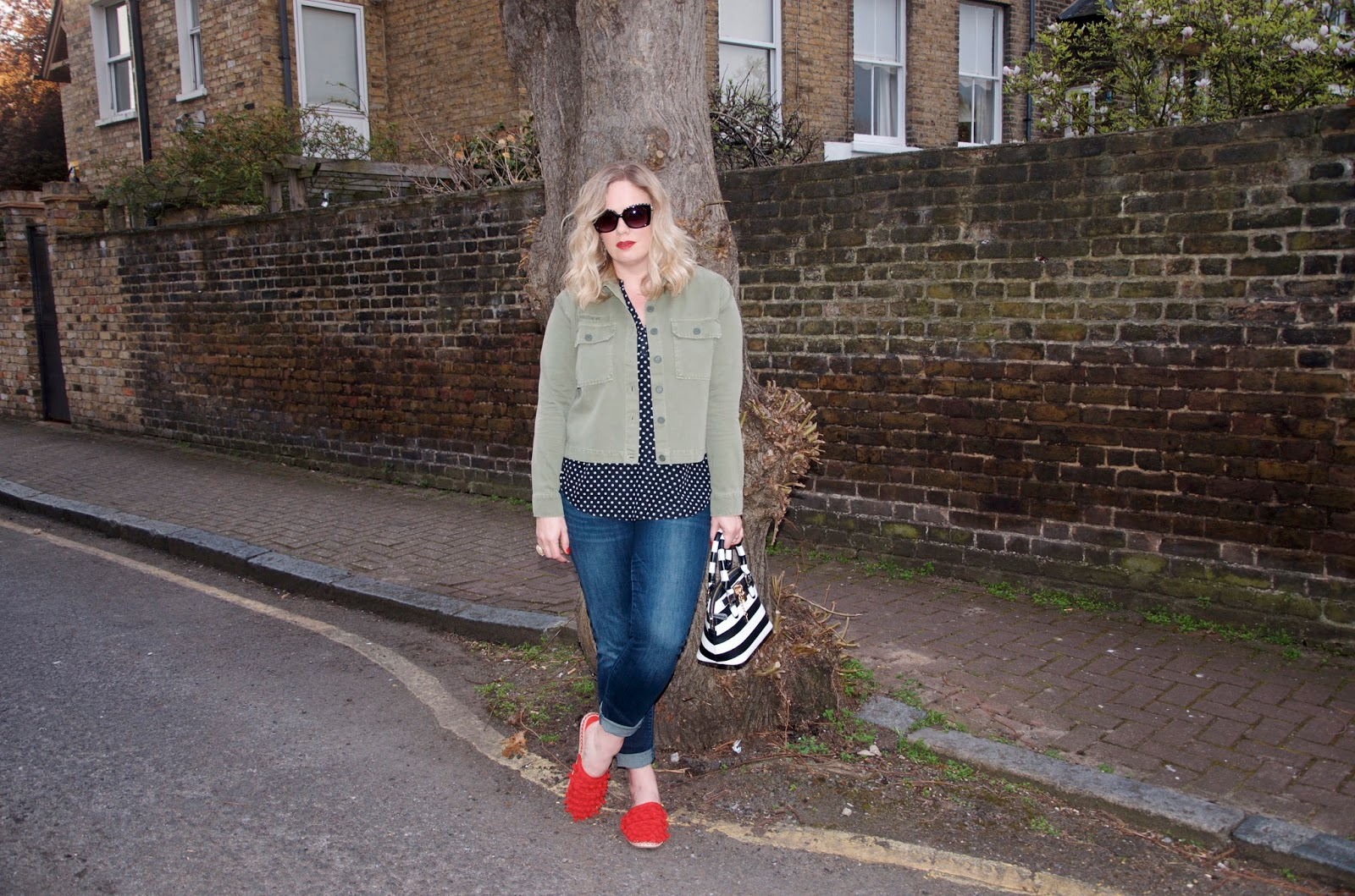 red mules, striped bag and green jacket