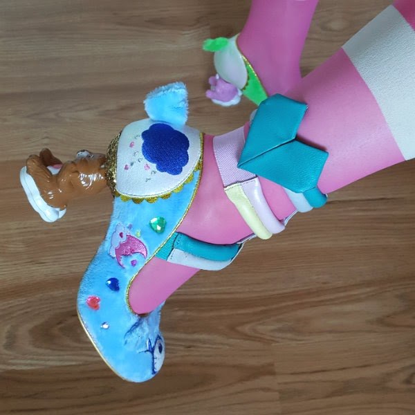 blue fluffy court shoe with Tenderheart Care Bear character heel and puffy strapped ankle cuff