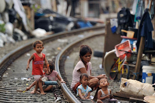 Kemiskinan : Permasalahan Ekonomi Makro dan Kebijakan Ekonomi Makro