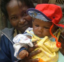 Image: Kenyan Kiss: Daughter and child in Kenya, Africa, by Amanda Kline on Freeimages