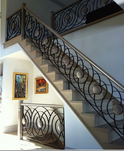 Trends of stair railing ideas and materials interior for Interior iron railing designs