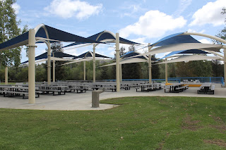 Picture of tables, chairs and canopies at the Lakeside Pavillion at Conjeo Creek North Park where the 2018 L.A. Conejo Valley Camp Fair will take place on Saturday, April 14, 2018