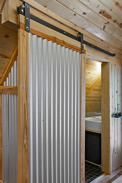 a metal tin roof leaf is adapted as a sliding barn door