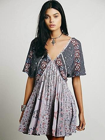 3e4d761da0ecf Bu etnik desenli elbise şahane görünüyor, ben çok beğendim. Roba ve  kollarda koyu renkli, diğer kısımlarda açık renkli karışık desenleri ve  arkadan bağlanan ...