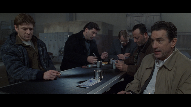 Robert De NIro, Sean Bean, Jean Reno, and company sitting around a table