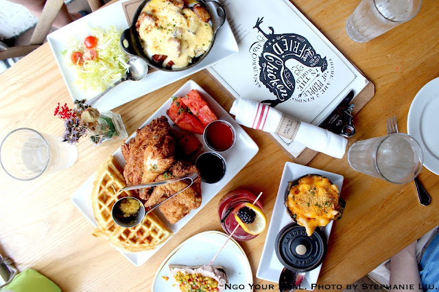 Chicken 'n' Watermelon 'n' Waffles, honey hot sauce, chilled spiced watermelon, cheddar cheese chow chow waffle, bourbon maple syrup at Yardbird Southern Table & Bar