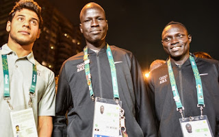 Three members of the Refugee Olympic Team attend a ceremony to welcome the team to the Olympic Village. © UNHCR/Benjamin Loyseau