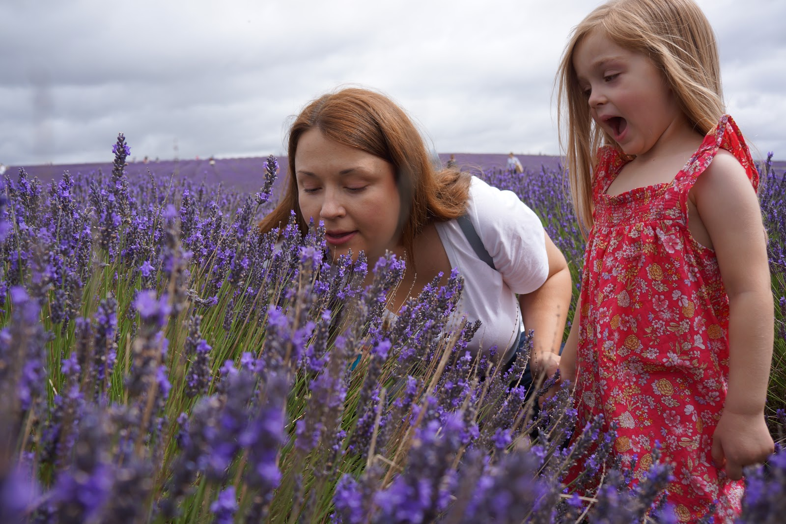 mum and daughter smelling lavender