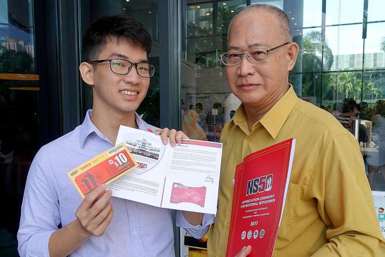 Mr Melvin Tan De Zheng, 26, and his father Dave Tan Jong, 65, were among the 500 national servicemen who received their NS50 packages at ceremonies yesterday.