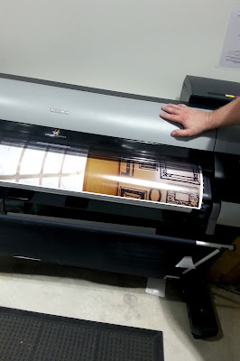 A1-sized photo being printed on a large printer.