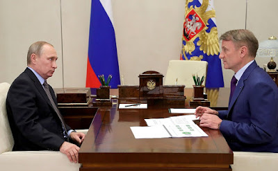 Vladimir Putin with CEO of Sberbank German Gref.
