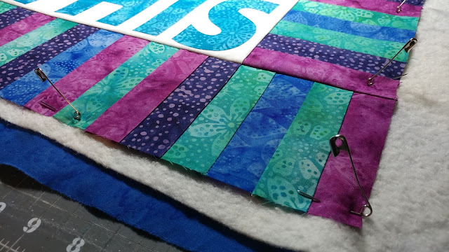 Pin basting a mini quilt with Hobbs batting