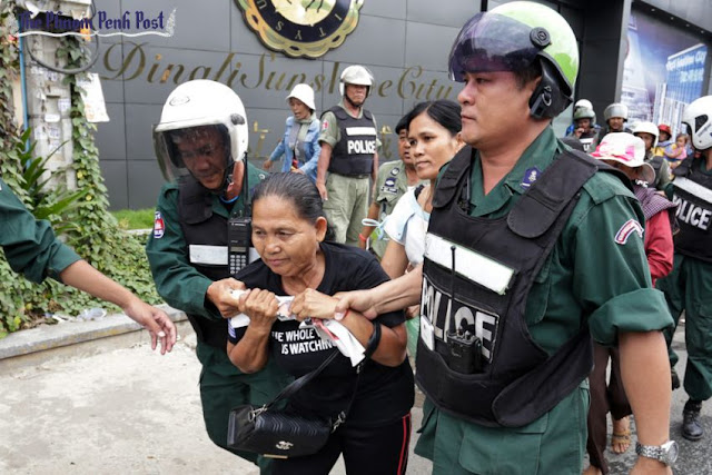 An activist is detained by authorities earlier this month during a Black Monday protest in Phnom Penh's Tuol Kork district. Hong Menea