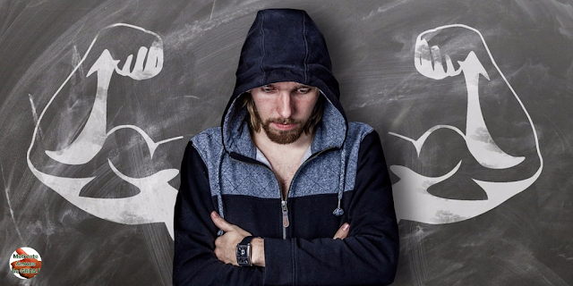 """Header image for the article: """"75 Quotes About Strength And Motivational Words For Hard Times"""". Man going trough hard times, finds strength and motivation"""