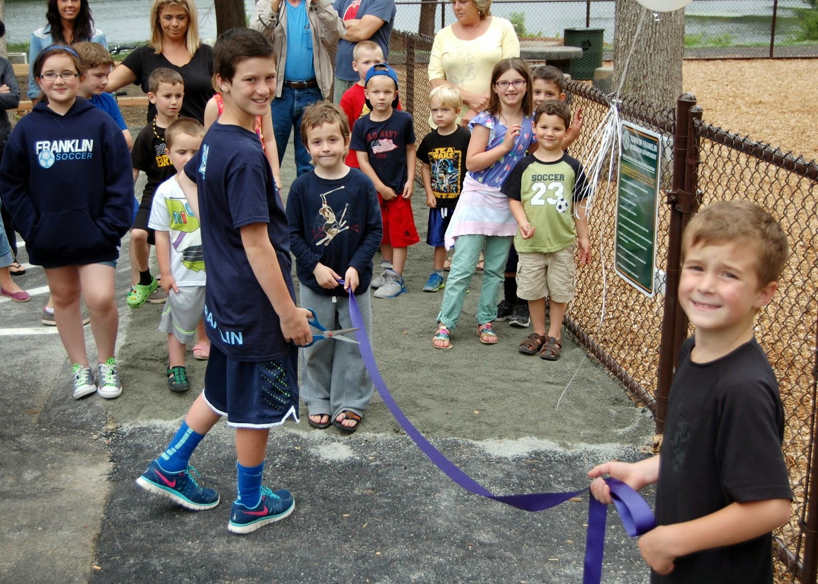 then it was time for some eager youths to cut the ribbon to the playground