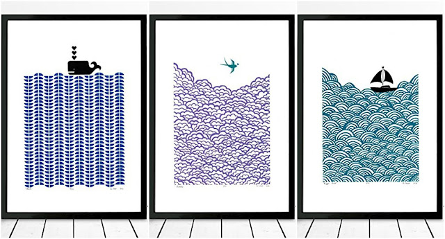 three white prints in black frames. left: blue waves with black whale, centre: teal sea bird, over blue waves right: black boat on teal waves