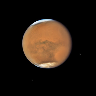 The atmosphere on Mars is going away, indicating a young planet.