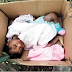 Baby found abandoned in carton near a refuse dump in Akwa Ibom, cries to death (PHOTO)