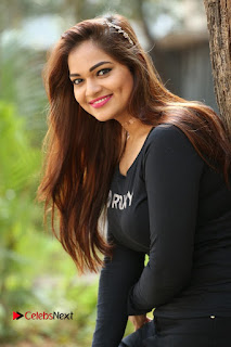 Actress Aswini Latest Stills in Black Denim Jeans  0038.JPG